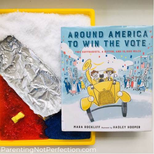 """Around America to Win the Vote"" book & sensory materials on a tray."