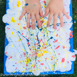 Paint Splattered Shaving Cream with hands touching it