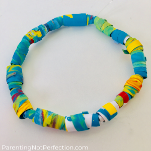 close up of paper bead friendship bracelet