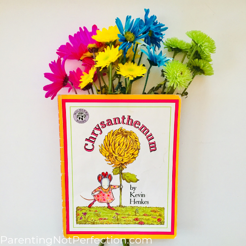 """Chrysanthemum"" book with bright colorful flowers behind it."