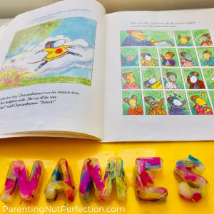 "Picture from inside ""Chrysanthemum"" of her leaping for joy on her way to school on the left and on the right all the kids in the class with their names. Underneath the book on the yellow tray is flower ice letters spelling ""names""."