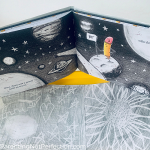 "two eraser drawings with ""when pencil met eraser"" book opened to a space drawing."