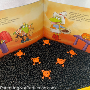 book opened to froggy's mom and froggy  with tray of black beans and orange flip frogs