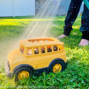 hose water spraying toy school bus
