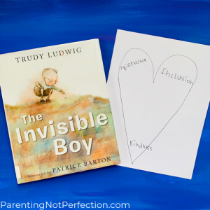 """The Invisible Boy"" book with heart drawing next to it"