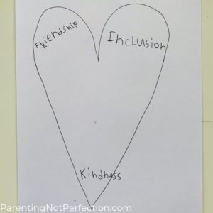 "heart drawing with the words ""friendship"", ""inclusion"" & ""kindness"" written inside of it"