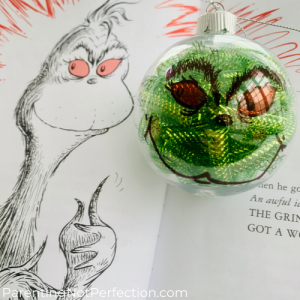 close up of same grinch illustration with completed DIY grinch ornament.
