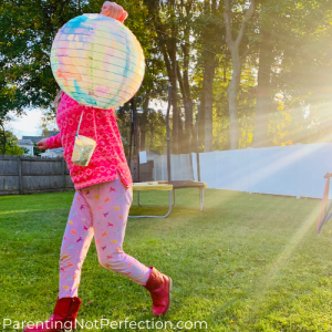 girl holding hot air balloon glitter sprinkler
