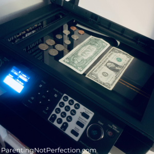 money on home printer screen ready to make a photo copy