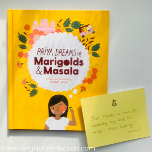 "cover of ""Priya Dreams of Marigolds & Masala"" with handwritten note form the author"