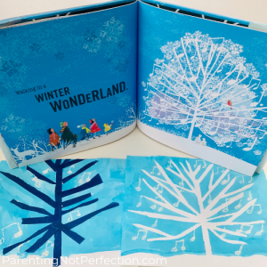 "tape resist art shown before and after tape is peeled off to expose musical tree as shown in ""Walking in a Winter Wonderland"" book (also pictured)."