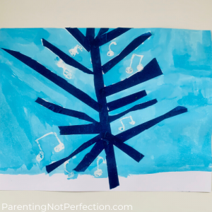 close up of tape tree with oil pastel music notes and watercolor painted blue