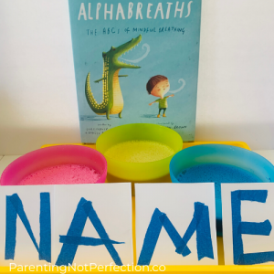 """Alphabreaths: The ABC's of Mindful Breathing book with red, yellow and blue bowls of colored bubbles and tape resist name print cards for literacy fun"