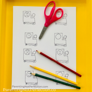 free printable of trains with scissors and colored pencils on a yellow tray
