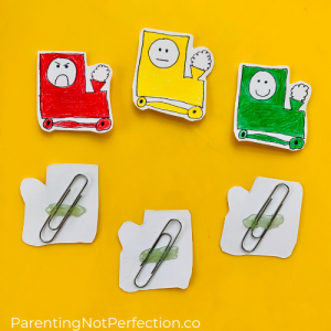 close up of front and back of free printable trains with paper clips glued to the back.
