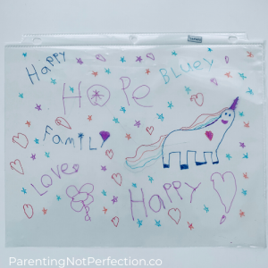 close up of completed doodles, including a unicorn and the words Blue, Hope, Happy, Family, Love.