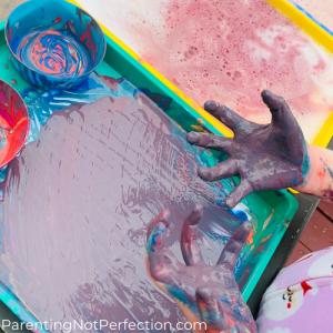 very messy purple hands and hidden bunny art