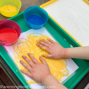 close up of hands painting bunny art yellow