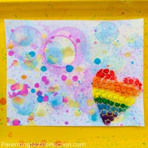 bubble art print with heart shaped rainbow painted bubble wrap