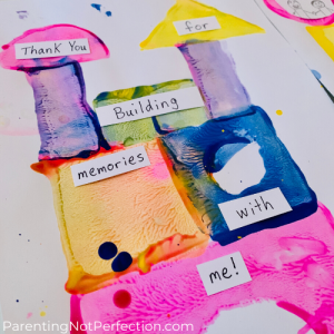 "close up of painting with blocks artwork with ""Thank You for building memories with me!"" message"