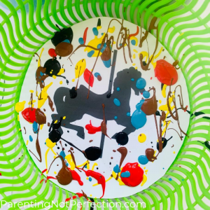 close up of carousel horse printable with paint drips all over before being spun in salad spinner