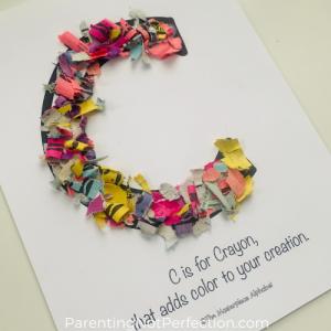 "close up of crayon wrapper confetti art Masterpiece Alphabet letter ""C"""